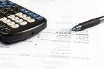 pit, kalkulator i długopis